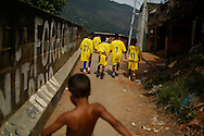 Kids of Nova Geracao (New Generation) leave the field after losing a soccer match against Futebol Clube Borel (Soccer Club Borel) during a local tournament at the Borel slum in Rio de Janeiro May 3; 2014. Photo/Pilar Olivares