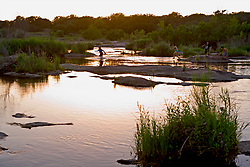 Stock photo of children playing in the Llano in the Texas Hill Country at sunset