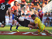 New Zealands Tim Mikkelson offloads the ball after being tackled during the Emirates Dubai rugby sevens match between Australia  and New Zealand  at the Sevens Stadium, Al Ain Road, United Arab Emirates on 3 December 2016. Photo by Ian  Muir.*** during the Emirates Dubai rugby sevens match between *** and *** at the Sevens Stadium, Al Ain Road, United Arab Emirates on 3 December 2016. Photo by Ian  Muir.