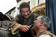 Scene from a street market in the Middle Ages with a man performing a dental extraction. Image taken from the filming of 'Paris la ville a remonter le temps' written by Carlo de Boutiny and Alain Zenou, directed by Xavier Lefebvre, a Gedeon Programmes production. Picture by Manuel Cohen