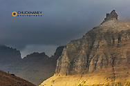 Bighorn sheep silhouetted on ridge with Bishops Cap in Glacier National Park, Montana, USA