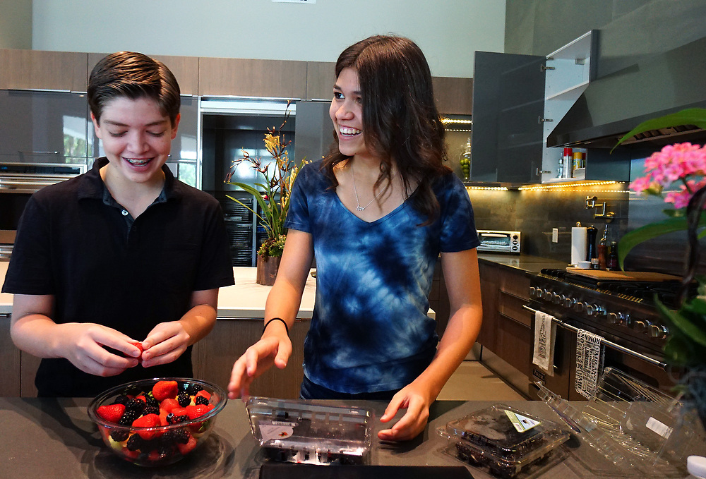 MAY 23, 2015---BOCA RATON, FLORIDA----<br /> Jordan Zietz, 13, and sister Rachel, 14, prepare a fruit salad  in their Boca Raton house. The siblings are following in their father's entrepreneurial footsteps and have successful businesses.