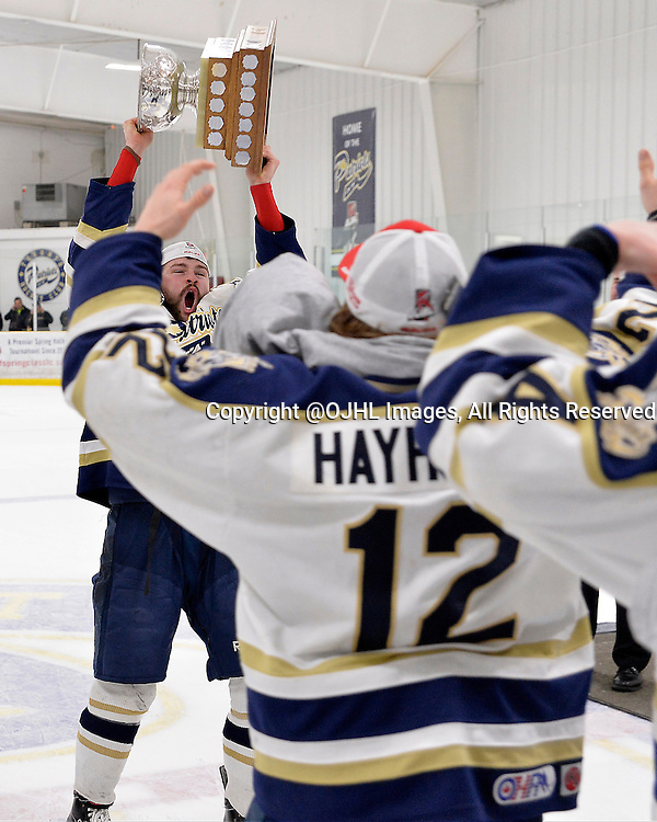 TORONTO, ON - Apr 22, 2015 : Ontario Junior Hockey League game action between the Toronto Patriots and the Kingston Voyageurs.  Game seven of the Buckland Cup Championship Series. Team Captain Luke Carter #15 brings the Buckland Cup to his teammates.<br /> (Photo by Shawn Muir / OJHL Images)