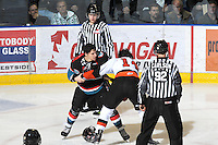 KELOWNA, CANADA, OCTOBER 11: Jessey Astles #27 of the Kelowna Rockets gets in the face of Cole Grbavac #14 of the Medicine Hat Tigers as the Medicine Hat Tigers visited the Kelowna Rockets on October 11, 2011 at Prospera Place in Kelowna, British Columbia, Canada (Photo by Marissa Baecker/shootthebreeze.ca) *** Local Caption ***Jessey Astels;Cole Grbavac;