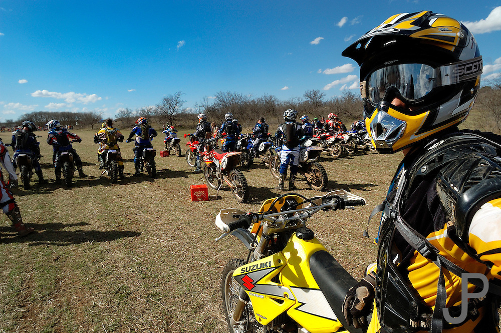 Adam Pratt on 2001 Suzuki DRZ-400K motorcycle at Oklahoma Cross Country Racing Association race in Erick, Oklahoma at starting line ready to begin race.