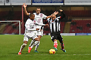 Grimsby Town striker Ashley Chambers (7)  under attack from Mauro Vilhete Barnet FC midfielder (32) and Curtis Weston Barnet FC midfielder (8)  during the EFL Sky Bet League 2 match between Grimsby Town FC and Barnet at Blundell Park, Grimsby, United Kingdom on 12 November 2016. Photo by Ian Lyall.