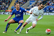 Swansea City midfielder Leon Britton turns away from Leicester City midfielder Danny Drinkwater during the Barclays Premier League match between Leicester City and Swansea City at the King Power Stadium, Leicester, England on 24 April 2016. Photo by Alan Franklin.