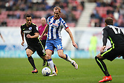 Wigan Athletic midfielder Shaun MacDonald (16) and Brighton & Hove Albion centre forward Sam Baldock (9) during the EFL Sky Bet Championship match between Wigan Athletic and Brighton and Hove Albion at the DW Stadium, Wigan, England on 22 October 2016.