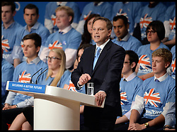 Image ©Licensed to i-Images Picture Agency. 28/09/2014. Birmingham, United Kingdom. Conservative Party Cahirman Grant Shapps during his speech to the  Conservative Party Conference.Picture by Andrew Parsons / i-Images