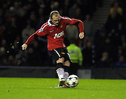 Wayne Rooney of Manchester United celebrates after scoring the winning goal from the penalty spot during the UEFA Champions League Group C match between Glasgow Rangers and Manchester United at Ibrox on November 24, 2010 in Glasgow, Scotland.