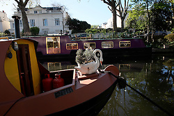 UK ENGLAND LONDON 2MAY16 - Swan flowerpot on the bow of a London Canal boat  at Blomfield Road moorings in Little Venice, Maida Vale, west London.<br /> <br /> jre/Photo by Jiri Rezac<br /> <br /> © Jiri Rezac 2016