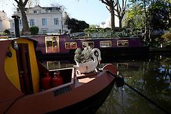 UK ENGLAND LONDON 2MAY16 - Swan flowerpot on the bow of a London Canal boat  at Blomfield Road moorings in Little Venice, Maida Vale, west London.<br /> <br /> jre/Photo by Jiri Rezac<br /> <br /> © Jiri Rezac 2016