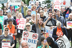April 28, 2017 - Atlanta, Georgia, U.S. - Protesters chant at a ''die-in'' protest held at Woodruff Park organized for the day of the NRA convention that Trump would be making an appearance at the National Rifle Association's convention. The protest would carry on to a march down Marietta street to the Omni Hotel and Georgia World Congress Center where the NRA Convention was held. (Credit Image: © Henry P. Taylor/TNS via ZUMA Wire)