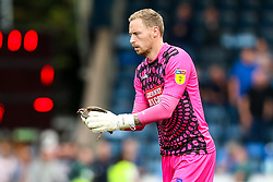 Ryan Allsop of Wycombe Wanderers removes a bird from the pitch which halted play - Mandatory by-line: Robbie Stephenson/JMP - 18/08/2018 - FOOTBALL - Adam's Park - High Wycombe, England - Wycombe Wanderers v Bristol Rovers - Sky Bet League One