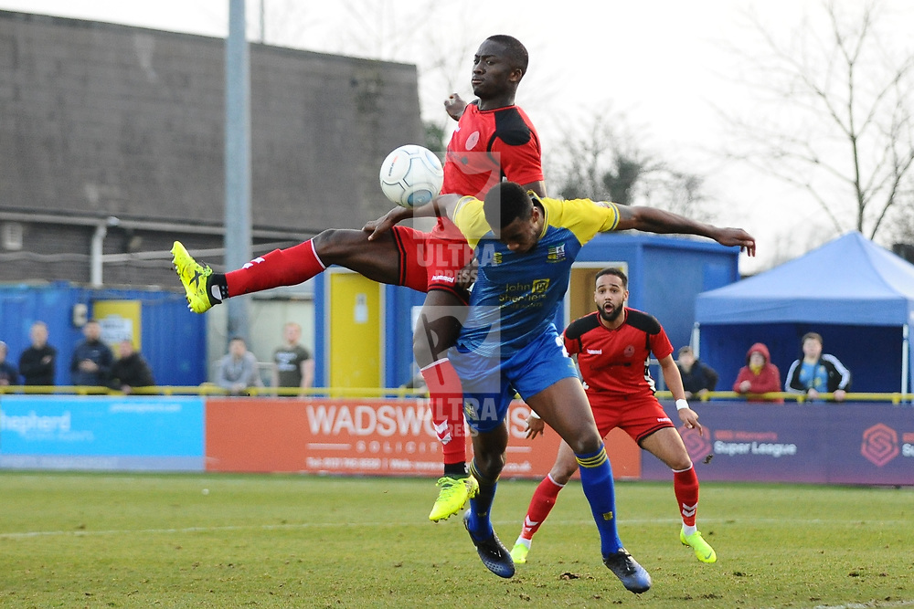 TELFORD COPYRIGHT MIKE SHERIDAN 23/2/2019 - Dan Udoh of AFC Telford battles for the ball with Tyrone Williams during the FA Trophy quarter final fixture between Solihull Moors and AFC Telford United at the Automated Technology Group Stadium