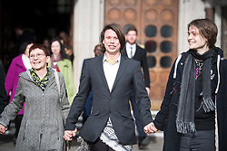 © Licensed to London News Pictures. 05/02/2018. London, UK. Alleged hacker Lauri Love leaves the High Court with his mother Sirkka-Liisa Love and his partner  Sylvia Mann, where he has won an appeal against extradition to the US over alleged cyber-hacking. Photo credit: Ben Cawthra/LNP