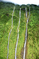 Aerial view taken from a helicopter of the top of 3 narrow waterfalls in Hawaii