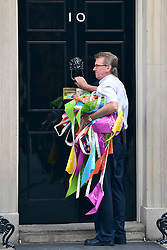 © Licensed to London News Pictures. 11/09/2012. Westminster, UK Olympic Bunting is removed from Downing Street today, the day after the Olympic Parade of Athletes. MP's arrive for Cabinet at number 10 Downing Street today 11/09/12. Photo credit : Stephen Simpson/LNP