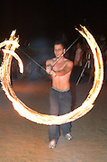 Man juggling fire night shot