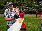 26 JUNE 2019 - CENTRAL CITY, IOWA: A child pumps water to get his duck going during duck races at the Linn County Fair. Summer is county fair season in Iowa. Most of Iowa's 99 counties host their county fairs before the Iowa State Fair, August 8-18 this year. The Linn County Fair runs June 26 - 30. The first county fair in Linn County was in 1855. The fair provides opportunities for 4-H members, FFA members and the youth of Linn County to showcase their accomplishments and talents and provide activities, entertainment and learning opportunities to the diverse citizens of Linn County and guests.       <br /> PHOTO BY JACK KURTZ