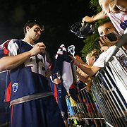 Rob Emery #42 of the Boston Cannons signs an autograph following the game at Harvard Stadium on August 9, 2014 in Boston, Massachusetts. (Photo by Elan Kawesch)
