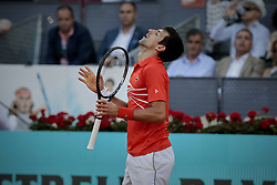 May 12, 2019 - Madrid, Madrid, Spain - Novak Djokovic from Serbia reacting during the Mutua Madrid Open Masters final match against Stefanos Tsitsipas from Greece on day eight at Caja Magica in Madrid..Novak Djokovic beats Stefanos Tsitsipas. (Credit Image: © Legan P. Mace/SOPA Images via ZUMA Wire)