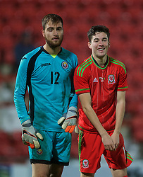 WREXHAM, WALES - Tuesday, November 17, 2015: Wales' Callum Saunders in action against Romania's Valentin Cojocaru during the UEFA Under-21 Championship Qualifying Group 5 match at the Racecourse Ground. (Pic by David Rawcliffe/Propaganda)