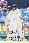 Ross Taylor of the New Zealand Black Caps celebrates his century with Kane Williamson of the New Zealand Black Caps during Day 3 on the 15th of November 2015. The New Zealand Black Caps tour of Australia, 2nd test at the WACA ground in Perth, 13 - 17th of November 2015.   Photo: Daniel Carson / www.photosport.nz