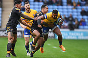 Bath wing Aled Brew (11) is tackled by Wasps wing Zach Kibirige(14) during the Gallagher Premiership Rugby match between Wasps and Bath Rugby at the Ricoh Arena, Coventry, England on 2 November 2019.