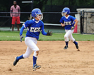 GLENSIDE, PA - MAY 29:  Conwell-Egan's Nicole Forktus (L) and Alex Kinnel run the bases against Swenson during the District 12 Class AA softball championship May 29, 2014 at Arcadia University in Glenside, Pennsylvania. Conwell-Egan defeated Swenson 15-0. (Photo by William Thomas Cain/Cain Images)