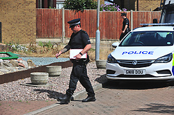&copy; Licensed to London News Pictures. 31/07/2018<br /> KEMSLEY, UK.<br /> Police house to house.<br /> A man has been arrested on suspicion of murder after a woman's body is found at a property in Hurst Lane, Kemsley near Sittingbourne. Police had to smash a window to get access to the property, police are on scene. <br /> Photo credit: Grant Falvey/LNP