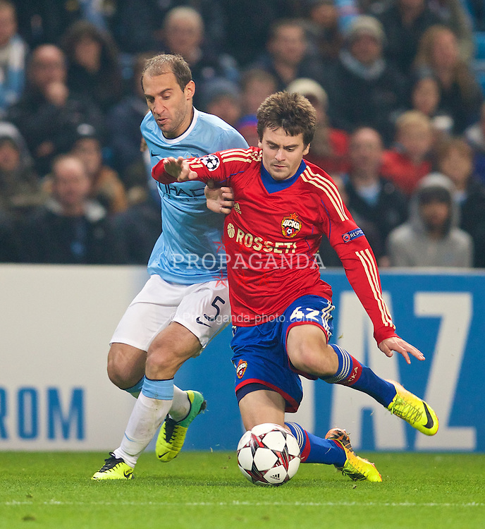 MANCHESTER, ENGLAND - Tuesday, November 5, 2013: Manchester City's Pablo Zabaleta in action against CSKA Moscow's Georgi Schennikov during the UEFA Champions League Group D match at the City of Manchester Stadium. (Pic by David Rawcliffe/Propaganda)
