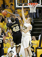 26 NOVEMBER 2007: Wake Forest guard L.D. Williams (42) tries to shoot over Iowa guard Dan Bohall (15) in Wake Forest's 56-47 win over Iowa at Carver-Hawkeye Arena in Iowa City, Iowa on November 26, 2007.