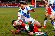 Workington Town winger Joe Hambley (2) in the tackle  during the Betfred League 1 match between Keighley Cougars and Workington Town at Cougar Park, Keighley, United Kingdom on 18 February 2018. Picture by Simon Davies.