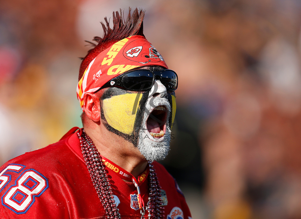 A Kansas City Chiefs fans yells prior to a preseason NFL football game against the Los Angeles Rams, Saturday, Aug. 20, 2016, in Los Angeles. (AP Photo/Rick Scuteri)