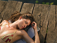 Young woman lying on jetty view from above