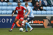 Swindon Town forward Jonathan Obika (20)  takes on Coventry City defender, on loan from Southampton, Jack Stephens (15)  during the Sky Bet League 1 match between Coventry City and Swindon Town at the Ricoh Arena, Coventry, England on 19 March 2016. Photo by Simon Davies.