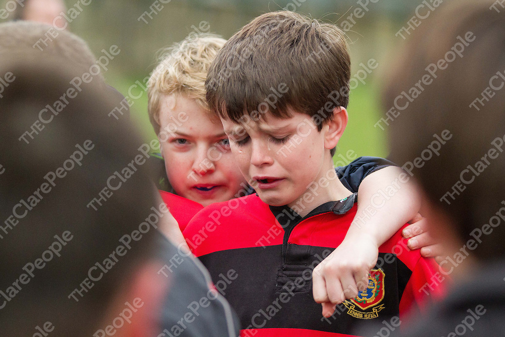 An emotional young Ennis player after the final whistle