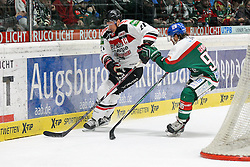 12.12.2014, Curt Fenzel Stadion, Augsburg, GER, DEL, Augsburger Panther vs Koelner Haie, 26. Runde, im Bild l-r: im Zweikampf, Aktion, mit John Tripp #21 (Koelner Haie) und Andy Reiss #96 (Augsburger Panther) // during Germans DEL Icehockey League 26th round match between Augsburger Panther vs Koelner Haie at the Curt Fenzel Stadion in Augsburg, Germany on 2014/12/12. EXPA Pictures © 2014, PhotoCredit: EXPA/ Eibner-Pressefoto/ Kolbert<br /> <br /> *****ATTENTION - OUT of GER*****