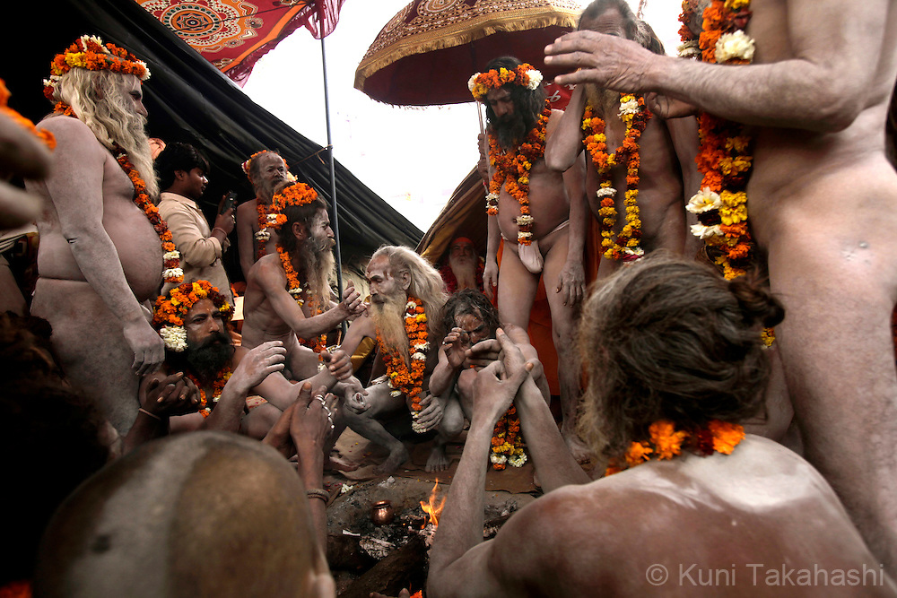 Sadhus (holy men) gather at their camp in Haridwar, India on Feb 2010 during Kumb Mela, largest Hindu gathering in the world. Hindus believe that bathing in the Ganges during the festival cleanses them of sin. Photo by Kuni Takahashi.