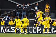 8 MAY 2010:  New England Revolutions' Pat Phelan (28) and Eric Brunner go up for a header during MLS soccer game between New England Revolution vs Columbus Crew at Crew Stadium in Columbus, Ohio on May 8, 2010. The Columbus defeated New England 3-2.