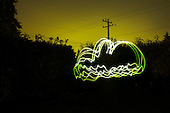 A green cloud created with a long exposure and light painting.