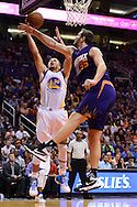 Feb 10, 2016; Phoenix, AZ, USA; Golden State Warriors guard Stephen Curry (30) drives the ball against Phoenix Suns forward Mirza Teletovic (35) at Talking Stick Resort Arena. The Golden State Warriors won 112-104. Mandatory Credit: Jennifer Stewart-USA TODAY Sports