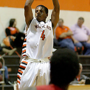 New Hanover's Shawn Robinson shoots over Scotland County's Ahmed Monley. (Jason A. Frizzelle)