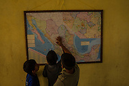 TENOSIQUE, MEXICO - JULY 2, 2014:  Undocumented migrant children look at a map of Mexico at the 72 migrant shelter in Tenosique. Even without official permission to stay, many migrants find an extensive system of church and nonprofit-run shelters helping them and making the journey north possible. PHOTO: Meridith Kohut for The New York Times