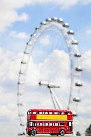 Figurine of double-decker bus with London Eye in the background