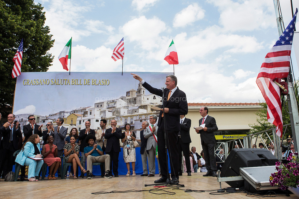 GRASSANO, ITALY - 24 JULY 2014: Mayor of New York Bil de Blasio thanks the woman who sang the American national anthem during a ceremony to celebrate his arrival in Grassano, his ancestral home town in Italy, on July 24th 2014.<br /> <br /> New York City Mayor Bill de Blasio arrived in Italy with his family Sunday morning for an 8-day summer vacation that includes meetings with government officials and sightseeing in his ancestral homeland.