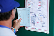PITTSBURGH, PA - AUGUST 16: Los Angeles Dodgers manager Don Mattingly checks the lineup card before a game against the Pittsburgh Pirates at PNC Park on August 16, 2012 in Pittsburgh, Pennsylvania. The Pirates won 10-6. (Photo by Joe Robbins)