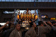 Mikoshi are carried around the streets of Asakusa through a covered shopping street called a shotengai during the Sanja matsuri. Asakusa, Tokyo, Japan. Friday May 13th 2016 The Sanja matsuri is one of the biggest festivals in Japan. Taking place over the 3 days of the second weekend of May (May 13th to 15th) it features many mikoshi, or portable shrines, that are carried around by local groups to bring blessings and prosperity to their neighbourhoods
