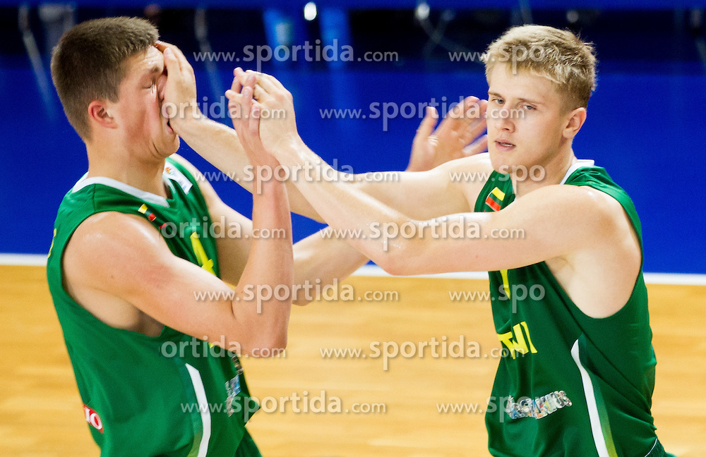 Paulius Vaitiekunas of Lithuania hit by Zygimantas Skucas of Lithuania during basketball match between National teams of Slovenia and Lithuania in First Round of U20 Men European Championship Slovenia 2012, on July 14, 2012 in Domzale, Slovenia. Slovenia defeated Lithuania 87-81. (Photo by Vid Ponikvar / Sportida.com)